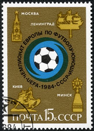 USSR - CIRCA 1984  A stamp printed in USSR  Russia  shows Soccer ball and emblems of cities with the inscription and name of series  European Youth Soccer Championship , 1984 , circa 1984 Stock Photo - 17561109