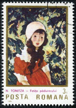 ROMANIA - CIRCA 1984  a stamp printed in Romania shows Portrait of Child, by N TONITZA, circa 1984 Stock Photo - 17560765
