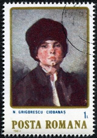 ROMANIA - CIRCA 1984  a stamp printed in Romania shows Portrait of Child, by N grigorescu, circa 1984 Stock Photo - 17560768