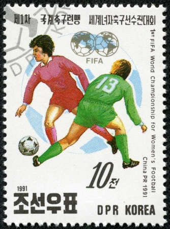 KOREA - CIRCA 1991  a stamp printed in North Korea Shows the Soccer Players with Inscription  1st fifia world championship for Women s football,china 1991 , circa 1991 Stock Photo - 17614930