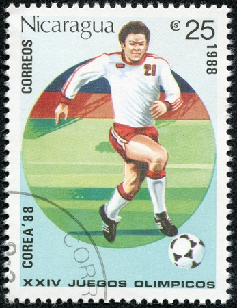 NICARAGUA - CIRCA 1988  A Stamp printed in NICARAGUA shows the Soccer Player , circa 1988 Stock Photo - 17614953