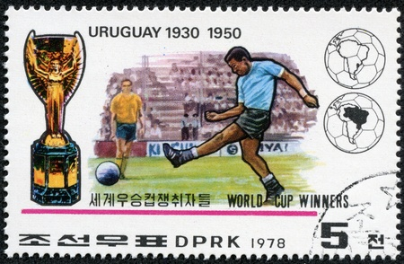 KOREA - CIRCA 1978  A Stamp printed in North Korea shows the Soccer players, Cup and Emblem with the inscription  Uruguay, 1930, 1950 , from the series  World Cup Winners , circa 1978