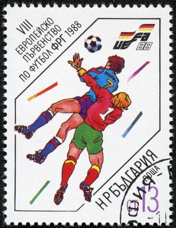 BULGARIA - CIRCA 1988  A stamp printed in BULGARIA, kicker and goalkeeper jumps for ball, 13 European football championship Germany, circa 1988