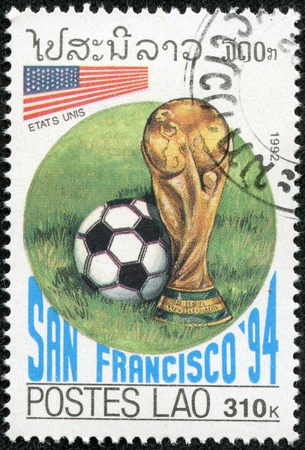 LAOS - CIRCA 1992  A stamp printed in Laos shows football game,Argentina VS Italy, circa 1992 Stock Photo - 17614945