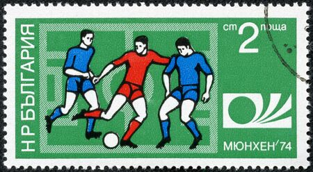 BULGARIA - CIRCA 1974  A Stamp printed in BULGARIA shows a football players and Munich  74 World Cup Emblem with the inscription  Munich  74 , from the series  FIFA World Cup 1974, Munich , circa 1974 Stock Photo - 17614926