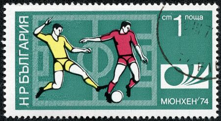 BULGARIA - CIRCA 1974  A Stamp printed in BULGARIA shows a football players and Munich  74 World Cup Emblem with the inscription  Munich  74 , from the series  FIFA World Cup 1974, Munich , circa 1974 Stock Photo - 17614928