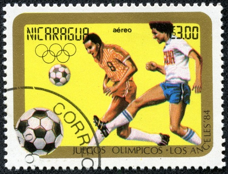 NICARAGUA - CIRCA 1984  A Stamp printed in NICARAGUA ,shows the football at the Olympic Games in Los Angeles, circa 1984 Stock Photo - 17554709