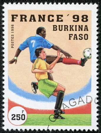 BURKINA FASO - CIRCA 1996  A stamp printed by Burkina Faso, shows 1998 World Cup Soccer Championships, France, circa 1996  Stock Photo - 17554725