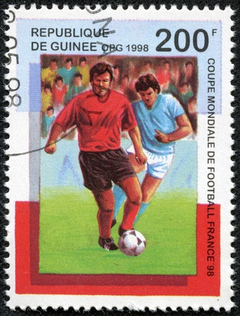 GUINEA - CIRCA 1998  A stamp printed in Guinea, shows a footballer, 1998 FIFA World Cup, circa 1998