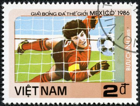VIETNAM - CIRCA 1985  a stamp printed by VIETNAM shows football players  World football cup in Mexico, circa 1985 Stock Photo - 17615014