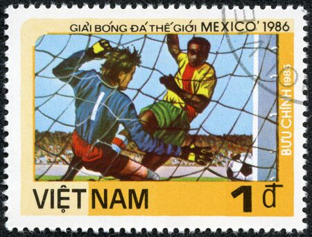 VIETNAM - CIRCA 1985  a stamp printed by VIETNAM shows football players  World football cup in Mexico, circa 1985 Stock Photo - 17615017