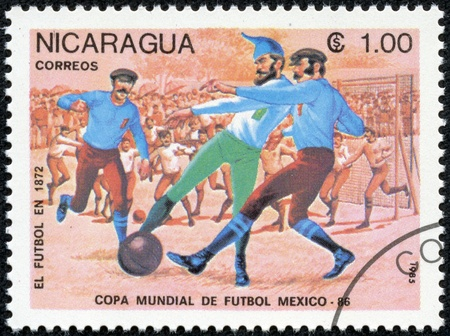 NICARAGUA - CIRCA 1985  A Stamp printed in NICARAGUA shows the Evolution of Soccer  1500 , World Cup Soccer Championships, Mexico, circa 1985 Stock Photo - 17615007