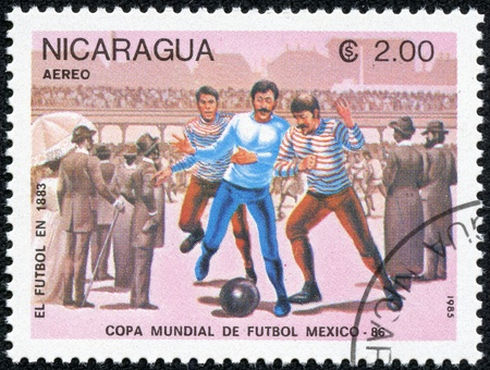 NICARAGUA - CIRCA 1985  A stamp printed in Nicaragua showing football circa 1985 Stock Photo - 17615026