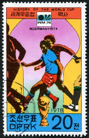 west of germany: KOREA - CIRCA 1978  A Postage Stamp Shows the Soccer Players with Inscription  West Germany 1974 , Series  History of World Cup , circa 1978