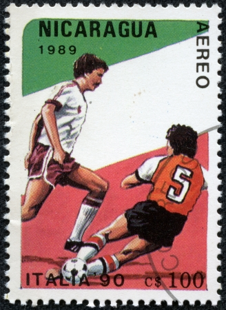 NICARAGUA - CIRCA 1989  A stamp printed in Nicaragua shows a soccer player, with inscription  Italy 90 , from the series  World Cup Football Championship, Italy  1990  , circa 1989