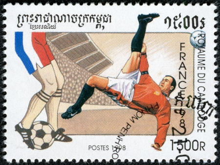 CAMBODIA - CIRCA 1998  A stamp printed in Kampuchea, shows footballers, 1998 FIFA World Cup, circa 1998