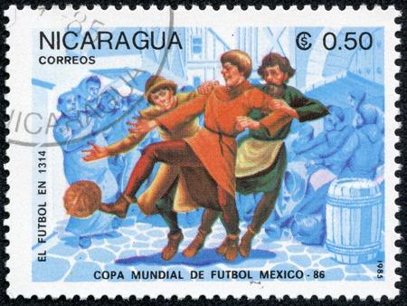 NICARAGUA - CIRCA 1985  A stamp printed in Nicaragua showing football circa 1985 Stock Photo - 17615013