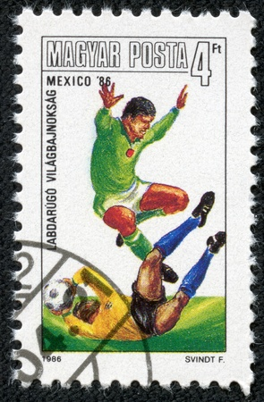HUNGARY-CIRCA 1986 A post stamp printed in Hungary, shows football players, devoted Football World Cup Championship, Mexico 1986, circa 1986  Stock Photo - 17614989