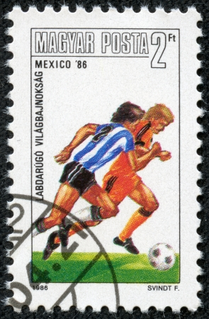 HUNGARY-CIRCA 1986 A post stamp printed in Hungary, shows football players, devoted Football World Cup Championship, Mexico 1986, circa 1986