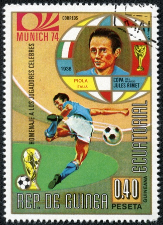 REPUBLIC OF EQUATORIAL GUINEA - CIRCA 1974  A stamp printed in the Republic of Equatorial Guinea shows football player  Champions Cup   Munich, Germany  and portrait piola Italy , circa 1974  Stock Photo - 17615044