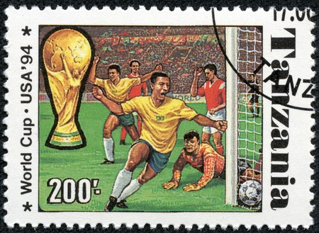 TANZANIA - CIRCA 1994  A stamp printed in Tanzania dedicated to FIFA World Cup, USA, 1994 shows footbal players, circa 1994 Stock Photo - 17615006