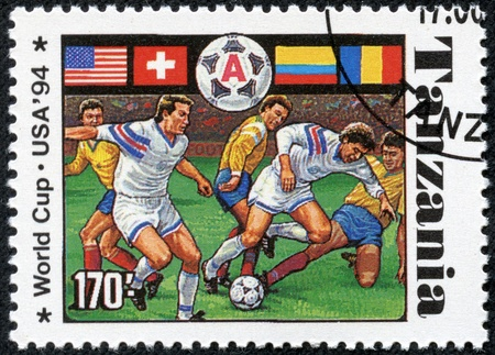TANZANIA - CIRCA 1994  A stamp printed in Tanzania dedicated to FIFA World Cup, USA, 1994 shows footbal players, circa 1994 Stock Photo - 17614993