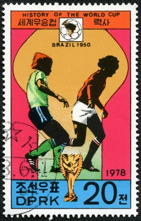 KOREA - CIRCA 1978  A Stamp printed in North Korea shows the Soccer players, Cup and Glob with the inscription  Brazil, 1950 , from the series  History of World Cup Football Championship , circa 1978