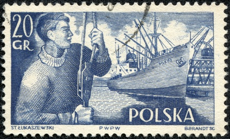 POLAND - CIRCA 1956  a stamp printed in the Poland shows Dock Worker and S  S  Pokoj, circa 1956