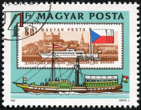HUNGARY - CIRCA 1981  A stamp printed in Hungary shows old and new stamps of boats on the Danube River in Budapest, Hungary  The older stamp shows Buda Castle, circa 1981