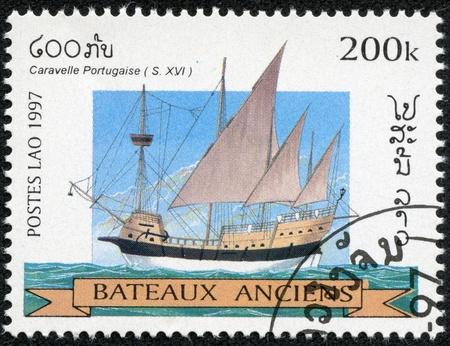 ketch: LAOS - CIRCA 1997  A stamp printed in Laos shows image of a sailing ship, circa 1997 Editorial