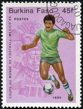 BURKINA FASO - CIRCA 1985  A stamp printed in Burkina Faso,shows World Cup Soccer Championships, circa 1985 Stock Photo - 17913793