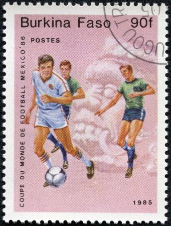 BURKINA FASO - CIRCA 1985  A stamp printed in Burkina Faso,shows World Cup Soccer Championships, circa 1985 Stock Photo - 17913794