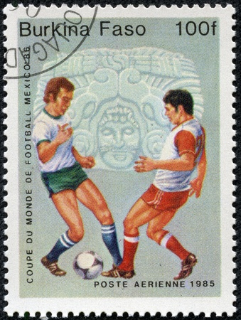 BURKINA FASO - CIRCA 1985  A stamp printed in Burkina Faso,shows World Cup Soccer Championships, circa 1985 Stock Photo - 17913796