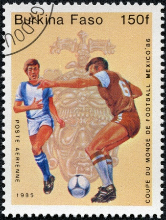 BURKINA FASO - CIRCA 1985  A stamp printed in Burkina Faso,shows World Cup Soccer Championships, circa 1985 Stock Photo - 17913790