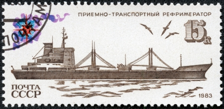 USSR - CIRCA 1983  Soviet postage stamp devoted to the Soviet fishing fleet, showing the receiving and transport refrigerator, circa 1983 Stock Photo - 17913818