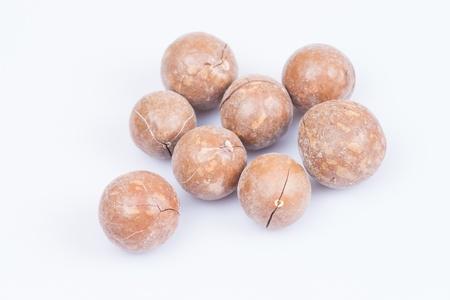 unshelled macadamia nuts on white background  photo