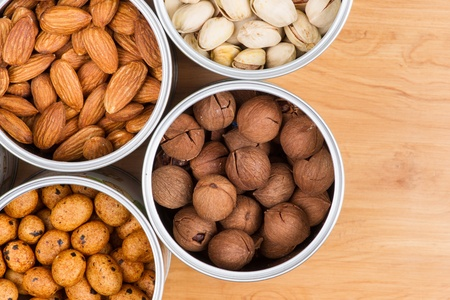 Assorted nuts in Iron pot Stock Photo - 17920501