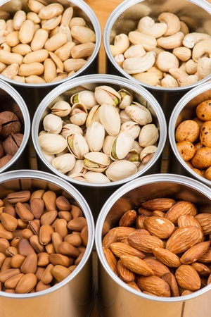 Assorted nuts in Iron pot   photo