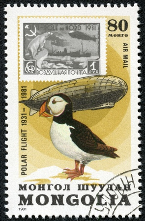 graf: MONGOLIA - CIRCA 1981  A Stamp printed in Mongolia shows the image of the Graf Zeppelin   Puffin from the series  Polar Flight 1931-1981 , circa 1981