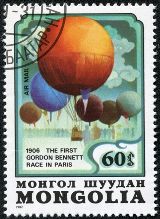 bennett: MONGOLIA - CIRCA 1982  a postage stamp printed in Mongolia showing an image of the first Gordon Bennett air balloon race in Paris, circa 1982  Editorial