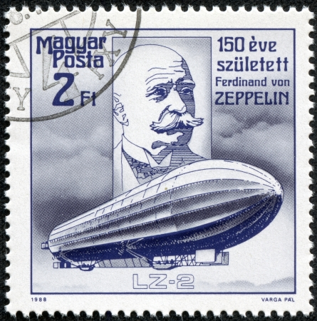ferdinand: HUNGARY - CIRCA 1988  A stamp printed in Hungary, shows Count Ferdinand von Zeppelin  airship pioneer  and Airship, with inscription and name of series  150 Birth Anniversary of Zeppelin , circa 1988