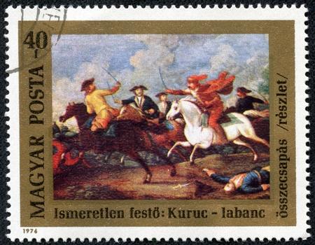 clash: Hungr�a - CIRCA 1976 Un sello impreso en Hungr�a expedido para el aniversario n�mero 300 del nacimiento del pr�ncipe Ferenc Rakoczi II muestra el enfrentamiento entre Kuruts Rakoczi s y soldados Habsburgos, alrededor del a�o 1976 Editorial