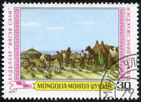 MONGOLIA - CIRCA 1979  stamp printed by Mongolia, shows milking, camels, circa 1979 Stock Photo - 18535474