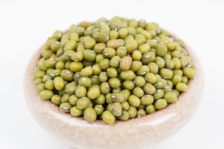 Green mung beans in bowl on white background photo