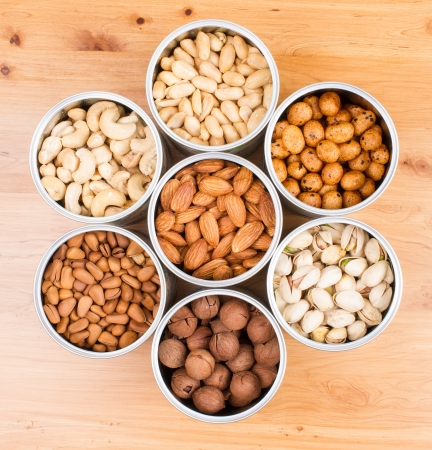 Assorted nuts in Iron pot  pecan, pistachios, almond, peanut, cashew,Pine nuts