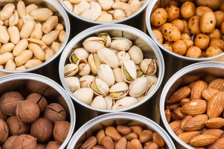 mixed nuts: Assorted nuts in Iron pot  pecan, pistachios, almond, peanut, cashew,Pine nuts  Stock Photo