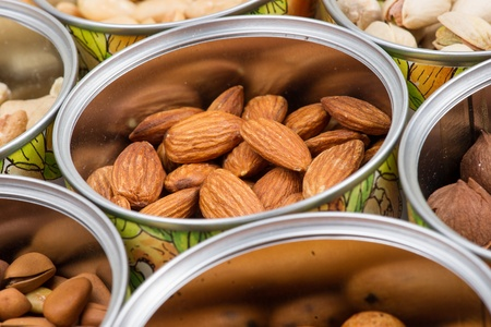 Assorted nuts in Iron pot  pecan, pistachios, almond, peanut, cashew,Pine nuts  photo