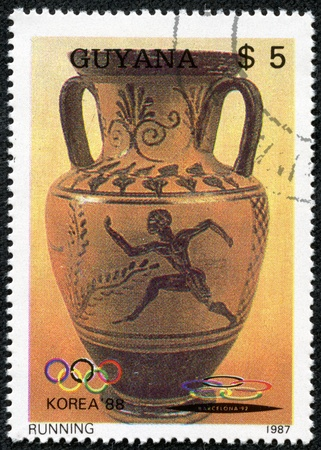 GUYANA - CIRCA 1987  A stamp printed in Guyana shows ancient Greek vase depicting a running man, with inscription  Korea, 1988 , from the series  Summer Olympics, Seoul, 1988 , circa 1987 photo