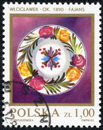 faience: POLAND - CIRCA 1982  A stamp printed in Poland shows a Stoneware Faience Plate, 1840  Wroclaw , with the same inscription, from the series  Polish Porcelain and Faience , circa 1982