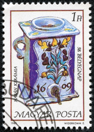 faience: HUNGARY - CIRCA 1985  stamp printed by Hungary, shows Faience water jar and dispenser, 1609, circa 1985 Editorial